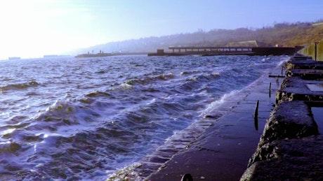Ocean waves breaking in the breakwater