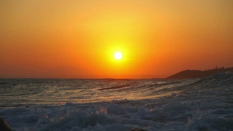 Ocean waves in the sunset
