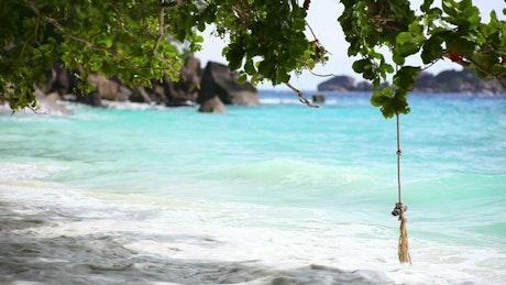 Ocean waves on tropical beachwith rocks