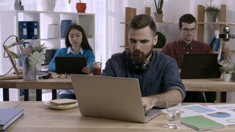 Office with people working on computers