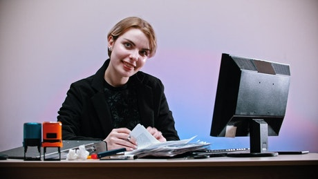 Office worker sarcastically shows a sadness sign
