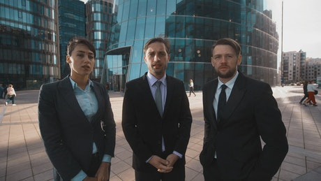 Office workers dressed in suits with disapproving gestures