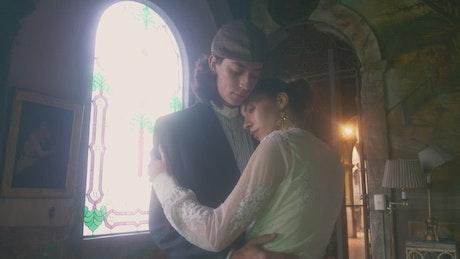 Old fashioned wedding couple hugging