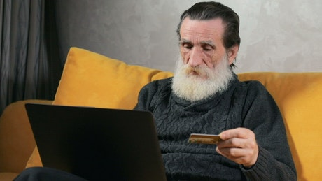 Old man shopping online