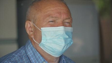 Old man wearing N95 mask