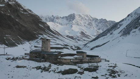 Old monastery in a snowy valley