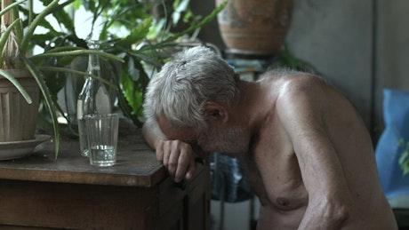 Old poor man depressed and drunk