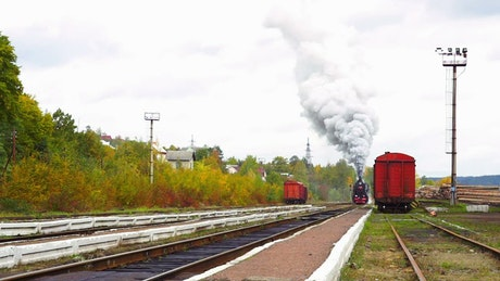 Old steam train arriving to the station