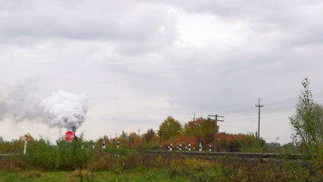 Old steam train crossing the countryside