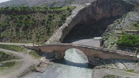 Old stone bridge across a river