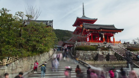 Old temple in Kyoto with tourist on the stairs