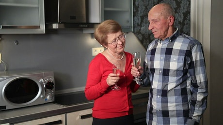 Older couple enjoying a drink