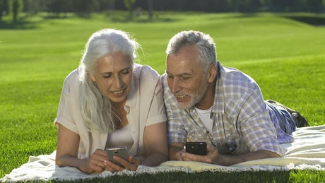 Older couple with their cellphones