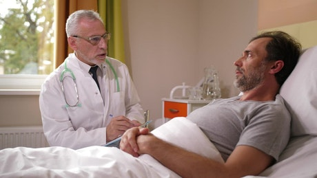 Older Doctor talking to a patient