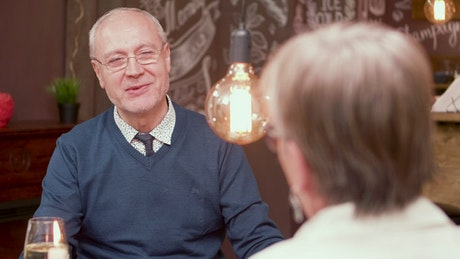 Older man chats about wedding and proposes on dinner date
