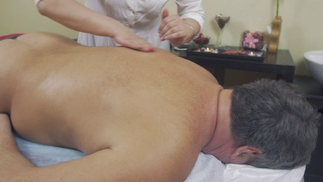 Older man having a back massage