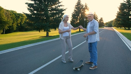 Older woman learning to skate