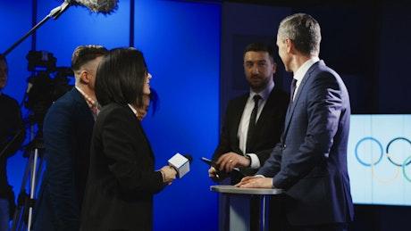 Olympics spokesman talking to journalists