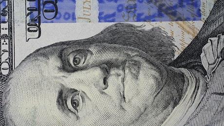 One hundred dollar bill spinning