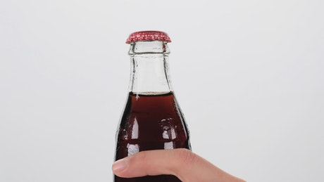 Opening a bottle of cola
