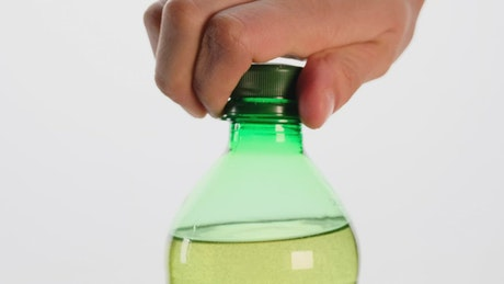 Opening a bottle soda bursting with foam