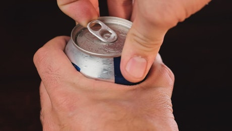 Opening a can of beer, close up view
