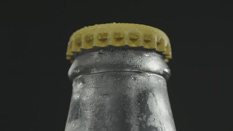Opening a cold drink bottle