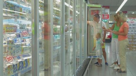 Opening a store refrigerator door