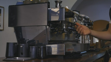 Operating a large coffee machine in a coffee shop