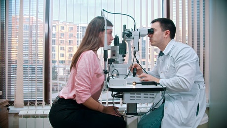 Optometrist checking a patient eyes