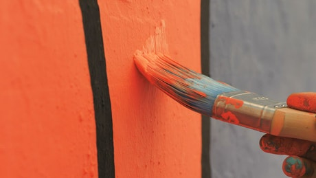 Orange paint on a mural
