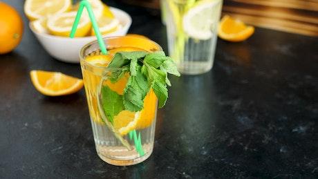 Orangeade with mint leaves