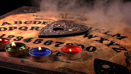Ouija board in a evil environment