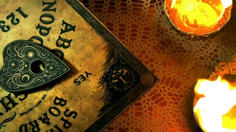 Ouija board spinning slowly
