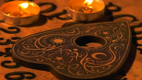 Ouija board with candles on it