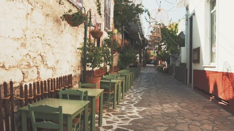 Outdoor restaurant seating on cobbled street