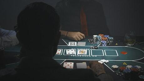 Over shoulder shot of a poker game