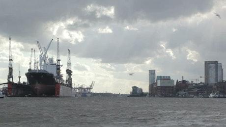 Overcast sky above an industrial port