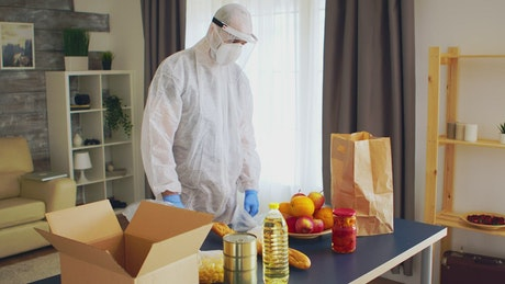 Packing groceries in PPE for coronavirus safety