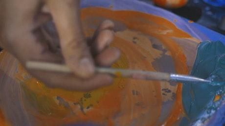 Painter mixing blue paint