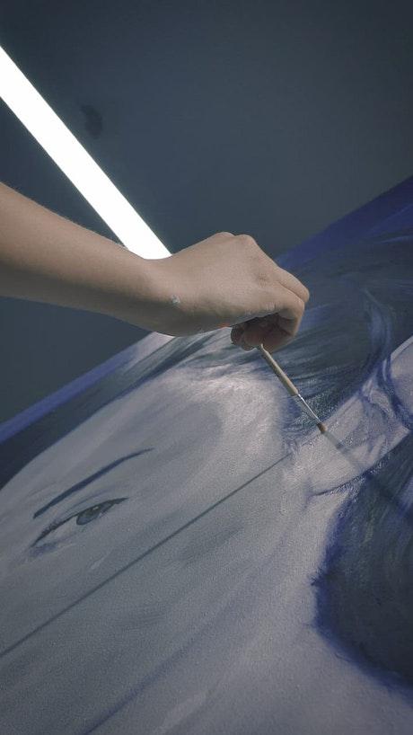 Painter painting an oil portrait