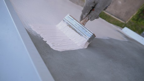 Painting a wall with white paint