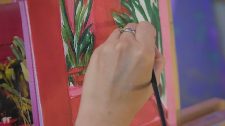 Painting of an artist on canvas