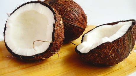 Pair of coconuts being wet by coconut water