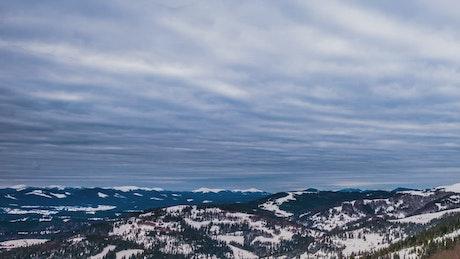 Pan shot of a cloudy winter landscape