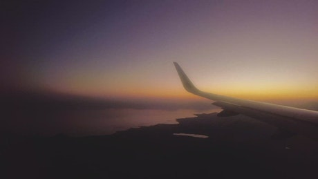 Panorama from the window of an airplane at dusk