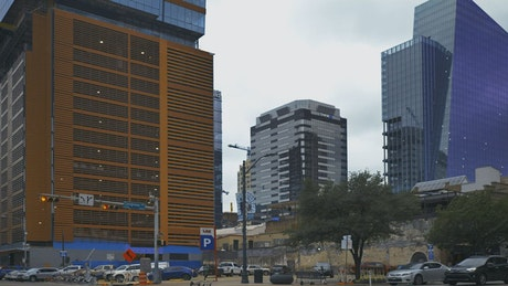 Panorama of a city with large buildings from the street