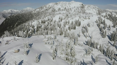 Panorama of a snowy hill