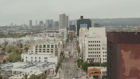 Panoramic view of Los Angeles, over an avenue