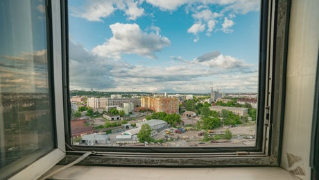 Panoramic view of the city from the window of an apartment